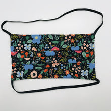 "Load image into Gallery viewer, Masks are made of 2 layers 100% quilting cotton featuring a multi colored flowers on black print, over the head elastic loops and a bendable aluminum nose. Wash in washing machine and dry in dryer after each use. 7"" H x 7.5"" W Rifle Paper Co designs."