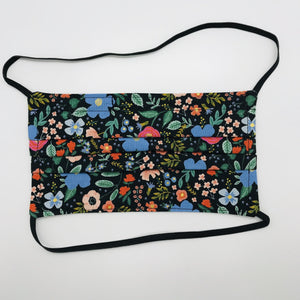 "Masks are made of 2 layers 100% quilting cotton featuring a multi colored flowers on black print, over the head elastic loops and a bendable aluminum nose. Wash in washing machine and dry in dryer after each use. 7"" H x 7.5"" W Rifle Paper Co designs."