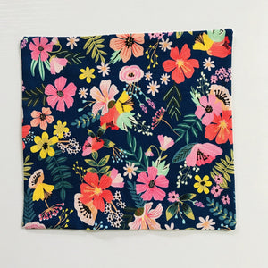 Image of flowers on navy cotton print.