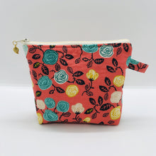 "Load image into Gallery viewer, The pouch is made from 100% cotton flowers on orange print and has a layer of fleece for structure and a cute metal tassel. The pouch design is from the Becca Bags pattern from Lazy Girl Design.  6""W x 4.5"" H x 1""D. Machine washable and dryer safe or air dry."