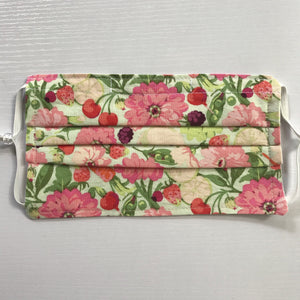 "Masks are made of 2 layers 100% quilting-weight cotton fabric featuring a garden veggies and flowers print, elastic adjustable ear and a bendable aluminum nose piece. Machine wash and dry after each use. 7"" H x 7.5"" W"