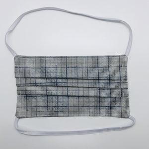 "Masks are made of 2 layers 100% quilting cotton featuring a blue and white graph print, behind the head elastic band and a bendable aluminum nose. Wash in washing machine and dry in dryer after each use. 7"" H x 7.5"" W"