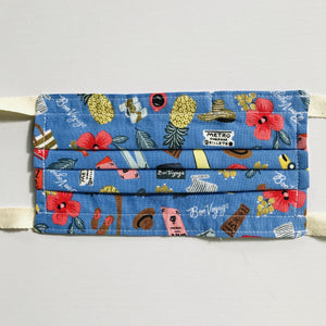 "100% quilting-weight blue, travel themed cotton face mask with twill tape straps and bendable nose piece. Washable, reusable fabric face mask. Wash in washing machine and dry in dryer after each use.  Fabric from the Les Fleurs collection by Rifle Paper co, designed by Ann Rifle Bond.  7"" H x 7.5"" W"