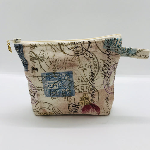 "The small pouch is made from 100% tan antique stamp print and has a layer of fleece for structure and a cute metal tassel. The pouch design is from the Becca Bags pattern from Lazy Girl Design. 6""W x 4.5"" H x 1""D. Machine washable and dryer safe or air dry."