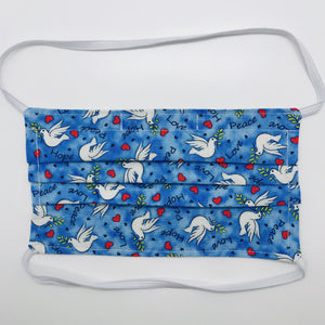 "100% quilting-weight cotton blue with white doves print fabric face mask with behind the head elastic bands and bendable nose piece. Washable, reusable fabric face mask. Wash in washing machine and dry in dryer after each use. 7"" H x 7.5"" W"