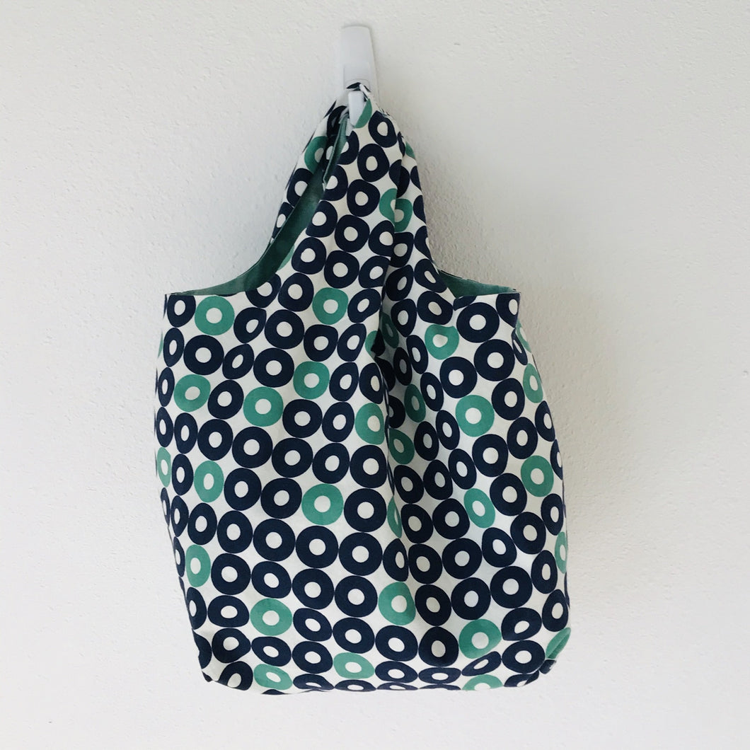 "The tote is made of 100% quilting-weight blue, green and white record shapes print cotton and is fully lined. Machine washable and dryable or hang dry. Size: 17"" x 21"". Fabric from Rotary Club collection by Cotton + Steel"