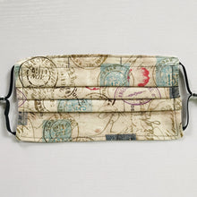 "Load image into Gallery viewer, Masks are crafted with two layers of 100% quilting-weight cotton fabric and are machine washable and dryable.  The novelty print theme and tan and off white colors give the stamps an antique look. The adjustable ear loops are made of elastic and tightened with a  bead to make them comfortable to fit a wider range of sizes. The masks also have a bendable aluminum nose piece which helps to make a better seal over the wearers face.    7"" H x 7.5"" W"