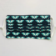 "Load image into Gallery viewer, 100% quilting-weight blue and green animal themed cotton face mask with adjustable elastic ear loops and bendable nose piece. Washable, reusable fabric face mask. Wash in washing machine and dry in dryer after each use. 7"" H x 7.5"" W  Butterflies in Ultra Marine - Pacific Collection - Elizabeth Hartman (designer)-Robert Kaufman Fabrics"