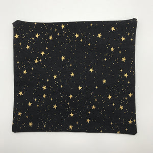 Image of metallic gold stars on black cotton print by Rifle Paper Designs.