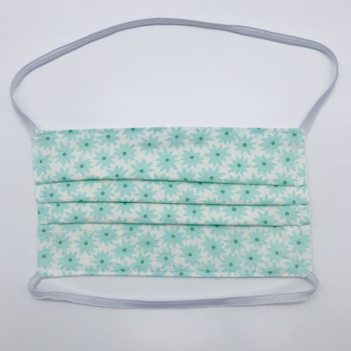 "Masks are made of 2 layers of aqua flowers on white print 100% quilting cotton and have behind the head elastic bands. The masks also have a bendable aluminum nose. Wash in washing machine and dry in dryer after each use. 7"" H x 7.5"" W"
