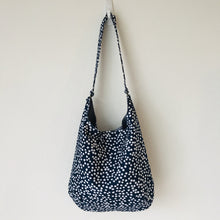 "Load image into Gallery viewer, This beautiful 100% quilting cotton of a white dots on blue print makes a great tote bag that is light and durable. The lining is beautiful Essex cotton\linen from Robert Kaufman and has a magnetic snap and inner pocket. 15.5"" W & 14""H. Total length with strap 33"""