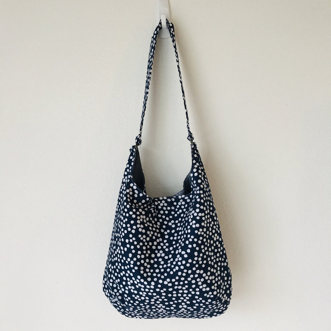 "This beautiful 100% quilting cotton of a white dots on blue print makes a great tote bag that is light and durable. The lining is beautiful Essex cotton\linen from Robert Kaufman and has a magnetic snap and inner pocket. 15.5"" W & 14""H. Total length with strap 33"""