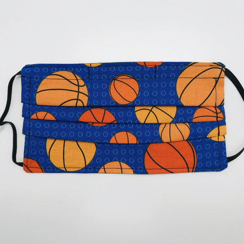 "Made with three layers of basketballs on blue print 100% quilting cotton, this mask includes a filter pocket located in the pleats in the back of the mask for a filter of your choice, adjustable elastic ear loops and a bendable aluminum nose. Machine wash and dry after each use. 7"" H x 7.5"" W"