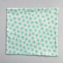 "Load image into Gallery viewer, 100% quilting-weight aqua green cotton face mask with twill tape straps and bendable nose piece. Washable, reusable fabric face mask. Wash in washing machine and dry in dryer after each use.  Fabric from the Pond collection by Elizabeth Hartman  7"" H x 7.5"" W"