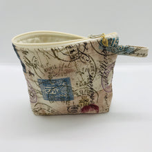 "Load image into Gallery viewer, The small pouch is made from 100% tan antique stamp print and has a layer of fleece for structure and a cute metal tassel. The pouch design is from the Becca Bags pattern from Lazy Girl Design. 6""W x 4.5"" H x 1""D. Machine washable and dryer safe or air dry."