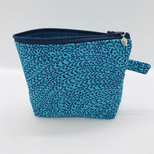 "Load image into Gallery viewer, The small pouch is made from 100% blue/teal vine maze print and has a layer of fleece for structure and a cute metal tassel. The pouch design is from the Becca Bags pattern from Lazy Girl Design. 6""W x 4.5"" H x 1""D. Machine washable and dryer safe or air dry."