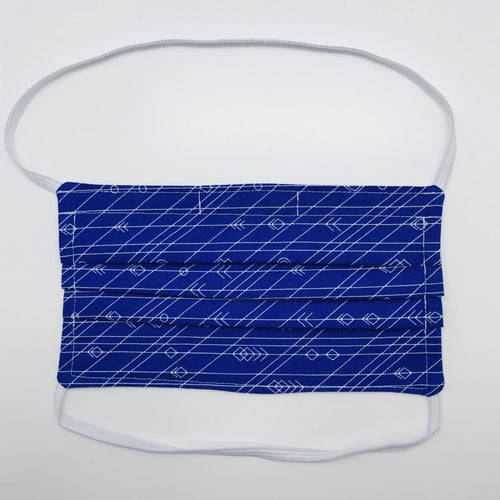 "Masks are made of 2 layers 100% quilting cotton featuring a white arrows, lines and circles on cobalt blue print, behind the head elastic band and a bendable aluminum nose. Wash in washing machine and dry in dryer after each use. 7"" H x 7.5"" W"