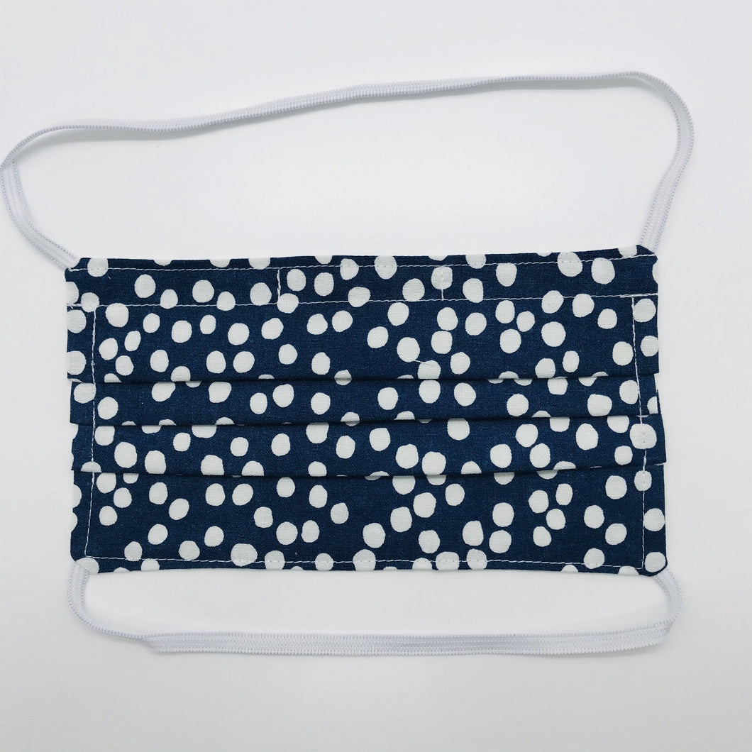 "Masks are made of 2 layers 100% quilting cotton featuring a white dots on blue print, over the head elastic loops and a bendable aluminum nose. Wash in washing machine and dry in dryer after each use. 7"" H x 7.5"" W"