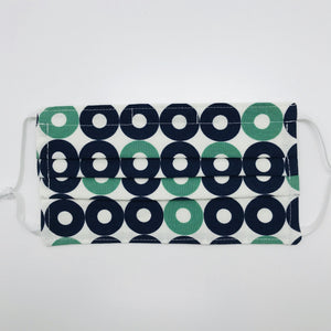 "Masks are made of 2 layers of 100% quilting-weight blue, green and white record shapes cotton print, elastic adjustable ear loops and a bendable aluminum nose piece. Machine wash and dry after each use. 7"" H x 7.5"" W Fabric from Rotary Club collection by Cotton + Steel"