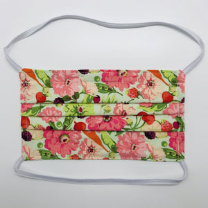 "Masks are made of 2 layers of garden veggies and flowers print 100% quilting cotton and have behind the head elastic bands. The masks also have a bendable aluminum nose. Wash in washing machine and dry in dryer after each use. 7"" H x 7.5"" W"