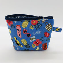"Load image into Gallery viewer, The small pouch is made from 100% blue travel themed print and has a layer of fleece for structure and a cute metal tassel. The pouch design is from the Becca Bags pattern from Lazy Girl Design. 6""W x 4.5"" H x 1""D. Machine washable and dryer safe or air dry."