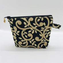 "Load image into Gallery viewer, The small pouch is made from 100% gold swirls on black print and has a layer of fleece for structure and a cute metal tassel. The pouch design is from the Becca Bags pattern from Lazy Girl Design. 6""W x 4.5"" H x 1""D. Machine washable and dryer safe or air dry."
