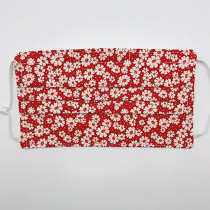 "Masks are made of 2 layers of 100% quilting-weight cotton fabric with a 30's retro simple daisy's on red print. . The elastic adjustable ear loops tightened with a craft bead to make them comfortable to fit a wider range of sizes. The masks also have a bendable aluminum nose piece which helps to make a better seal over the wearers face. Machine wash and dry after each use.     7"" H x 7.5"" W"
