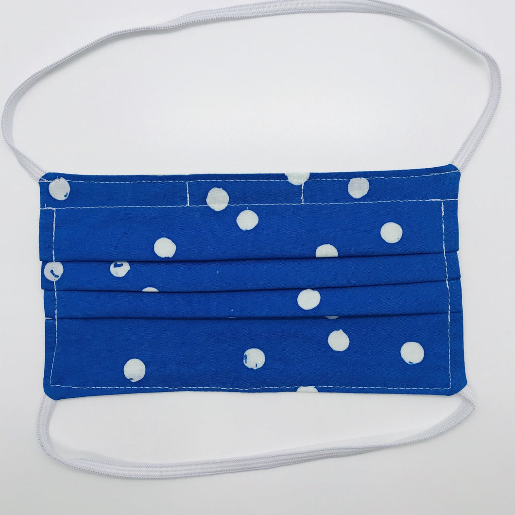 "Masks are made of 2 layers 100% batik quilting cotton featuring a white dot on blue print, over the head elastic loops and a bendable aluminum nose. Wash in washing machine and dry in dryer after each use. 7"" H x 7.5"" W"