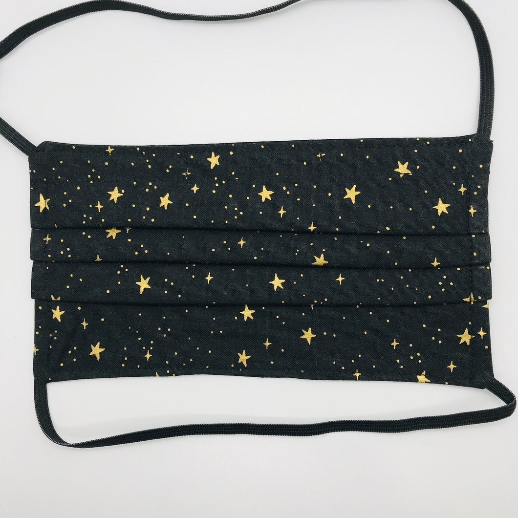 "Masks are made of 2 layers 100% quilting cotton featuring a metallic gold stars on black print, over the head elastic loops and a bendable aluminum nose. Wash in washing machine and dry in dryer after each use. 7"" H x 7.5"" W.  Rifle Paper Co designs."
