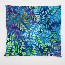 Load image into Gallery viewer, Image of blue, green and purple leaves on a cotton batik fabric.