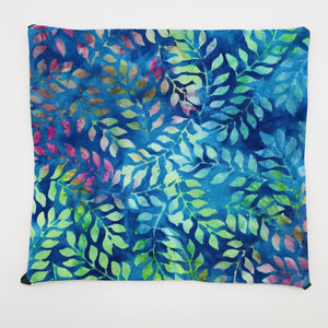 Image of blue, green and purple leaves on a cotton batik fabric.