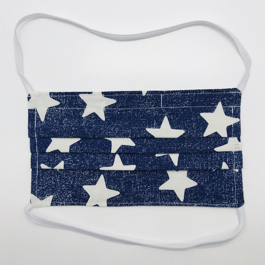 "Masks are made of 2 layers 100% quilting cotton featuring a white stars on blue print, over the head elastic loops and a bendable aluminum nose. Wash in washing machine and dry in dryer after each use. 7"" H x 7.5"" W"
