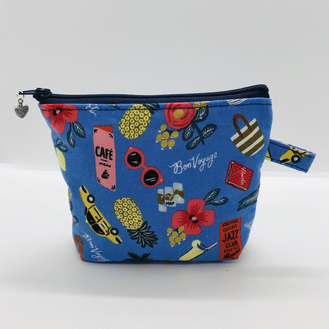 "The small pouch is made from 100% blue travel themed print and has a layer of fleece for structure and a cute metal tassel. The pouch design is from the Becca Bags pattern from Lazy Girl Design. 6""W x 4.5"" H x 1""D. Machine washable and dryer safe or air dry."