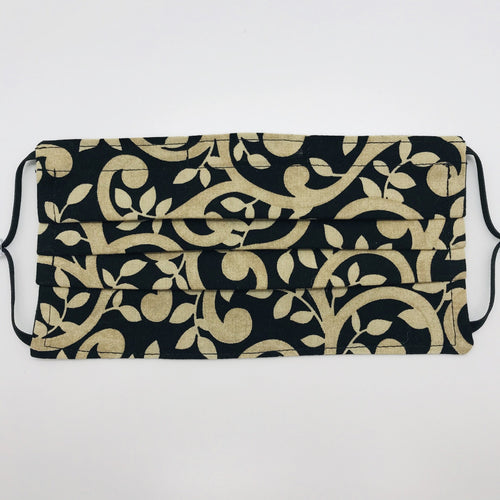 "Masks are made of 2 layers of 100% quilting-weight gold swirls on black cotton fabric.  The elastic adjustable ear loops tightened with a  bead to make them comfortable to fit a wider range of sizes. The masks also have a bendable aluminum nose piece.  Machine wash and dry after each use.     7"" H x 7.5"" W"