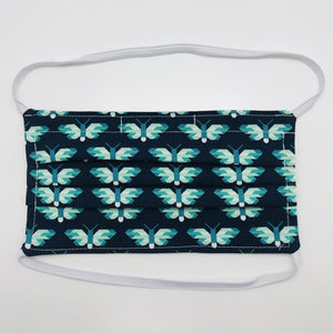 "Masks are made of 2 layers of green and white butterflies on navy print 100% quilting cotton and have behind the head elastic bands. The masks also have a bendable aluminum nose. Wash in washing machine and dry in dryer after each use. 7"" H x 7.5"" W"