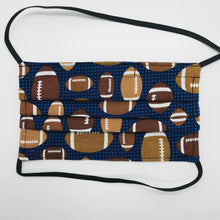 "Load image into Gallery viewer, Made with three layers footballs on blue print 100% quilting cotton, this mask includes a filter pocket located in the pleats in the back of the mask for a filter of your choice, elastic head bands and a bendable aluminum nose. Machine wash and dry after each use. 7"" H x 7.5"" W"