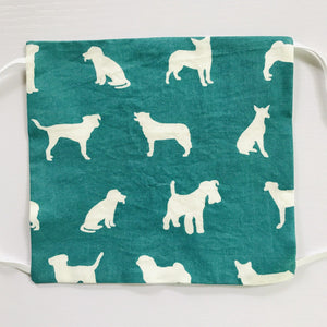 Image of white dogs on green cotton print.