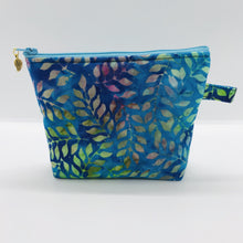 "Load image into Gallery viewer, The pouch is made of 100% batik quilting cotton of blue, purple and green leaves and a layer of fleece for stability. The cute metal tassel gives an added touch. 6""W x 4.5"" H x 1""D. Machine washable and dryer safe, or air dry."