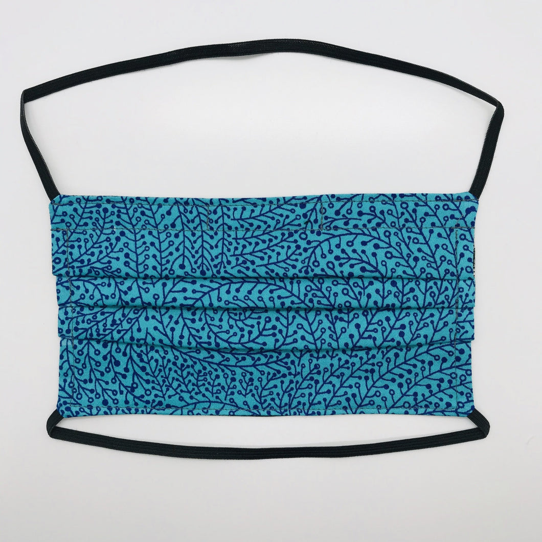 "Masks are made of 2 layers 100% quilting cotton featuring a black vines on blue print, over the head elastic loops and a bendable aluminum nose. Wash in washing machine and dry in dryer after each use. 7"" H x 7.5"" W"