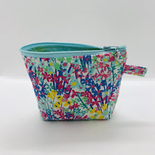 "Load image into Gallery viewer, The small pouch is made from 100% cotton spring flowers print and has a layer of fleece for structure and a cute metal tassel. The pouch design is from the Becca Bags pattern from Lazy Girl Design. 6""W x 4.5"" H x 1""D. Machine washable and dryer safe or air dry."