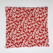 Load image into Gallery viewer, Image of 30's retro simple daisy's on red fabric print.