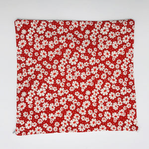 Image of 30's retro simple daisy's on red fabric print.