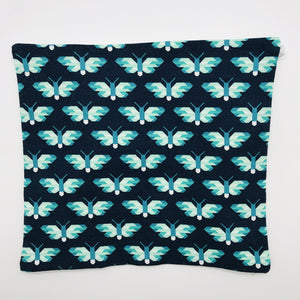 Image of green and white butterflies on navy cotton print.