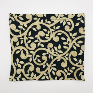 Image of gold swirls on black cotton print.