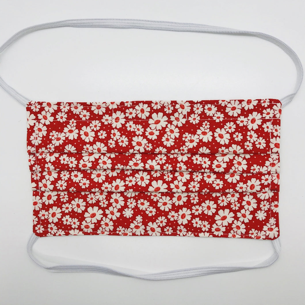 "Masks are made of 2 layers of 100% quilting-weight cotton with a 30's retro simple daisy red fabric print  and have behind the head elastic bands. The masks also have a bendable aluminum nose piece which helps to make a better seal over the wearers face. Wash in washing machine and dry in dryer after each use. 7"" H x 7.5"" W"
