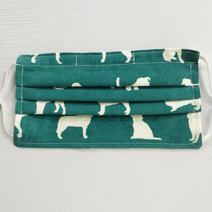 "Made with three layers of white dogs on green black print 100% quilting cotton, this mask includes a filter pocket located in the pleats in the back of the mask for a filter of your choice, adjustable elastic ear loops and a bendable aluminum nose. Machine wash and dry after each use. 7"" H x 7.5"" W"