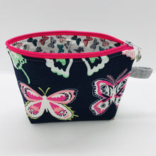 "Load image into Gallery viewer,  The pouch is made of 100% quilting cotton from Art Gallery features a large pink and white butterflies on navy print and a layer of fleece for stability. The cute metal tassel gives an added touch. 6""W x 4.5"" H x 1""D. Machine washable and dryer safe, or air dry."
