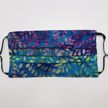 "Load image into Gallery viewer, Masks are made of 2 layers of 100% quilting-weight batik cotton of blue, green and purples leaves. The masks have elastic adjustable ear loops and a bendable aluminum nose piece. Machine wash and dry after each use. 7"" H x 7.5"" W"