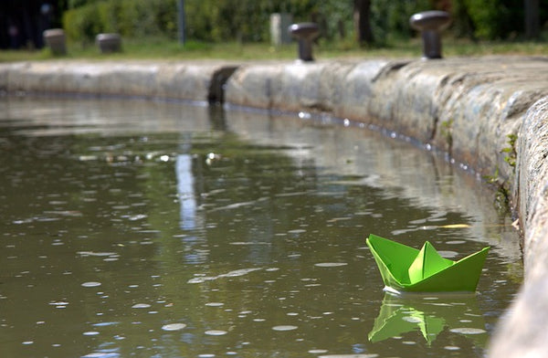 paper boat in pond