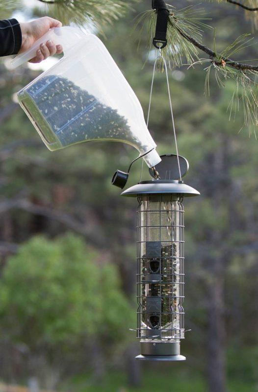 filling the Squirrel-X by More Birds X4 SureFill No Spill Squirrel-Resistant Bird Feeder with the More Birds 3-in-1 Super Tote